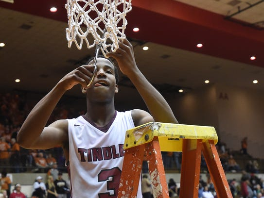 Tindley's Hunter White cuts down part of the net after