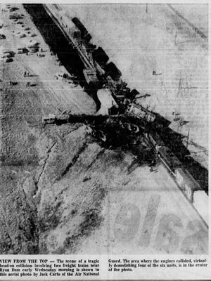 VIEW FROM THE TOP: The scene of a tragic head-on collision involving two freight trains near Ryan Dam is shown in this aerial photo by Jack Carte of the Air National Guard. The area where the engines collided, virtually demolishing four of the six units, is in the center of the photo.