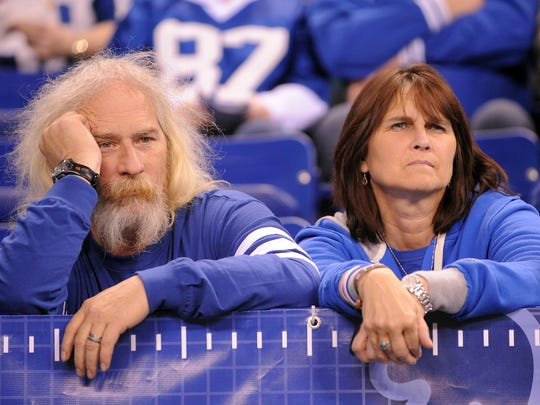 Dejected Indianapolis Colts fans Kevin and  Teresa Conner watch the game against the New York Jets Dec. 27, 2009 at Lucas Oil Stadium. The Colts had a chance at perfection, but lost to the Jets after pulling their starters.