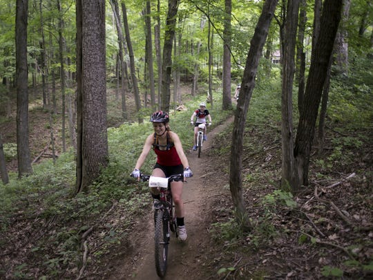 Mountain bikers participating in the Midwest Women's Mountain Bike Clinic take a trail ride in Brown County State Park, Nashville, on June 9.