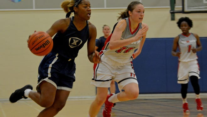 Kindell Fincher (left) scored 17 points Thursday to lead Xavier to an 84-32 rout of the A-Game All-Stars in a Thursday exhibition game in Toronto.