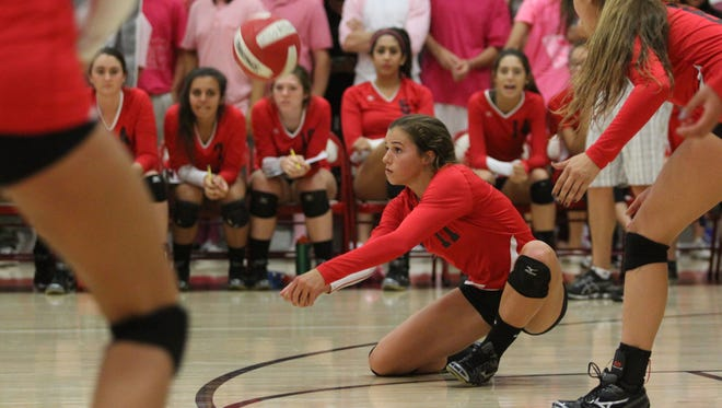Palm Springs' Mary Lake digs against Palm Desert on Thursday, October 10, 2013 in Palm Desert. Lake, the CIF Southern Section Division 2A MVP in 2014, will miss 2015 with a knee injury.