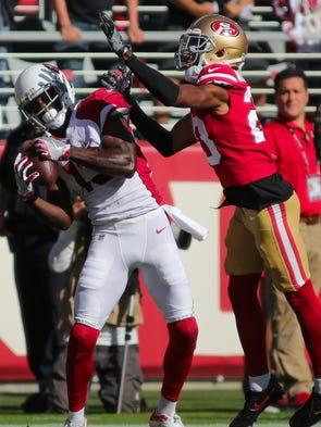 Arizona Cardinals wide receiver Jaron Brown grabs a