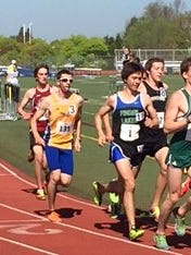 Chuck Collins (1) of Finger Lakes CC was named the men's Track Runner of the Year among Division III junior colleges.