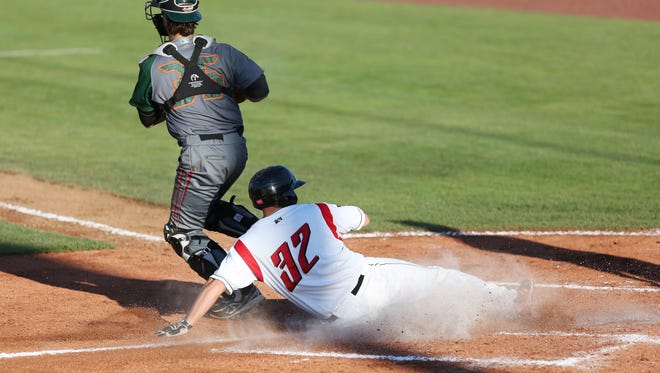 Salem-Keizer's John Riley slides home as the Volcanoes take on the Boise Hawks during a game on Tuesday, July 19, 2016, at Volcanoes Stadium in Keizer.