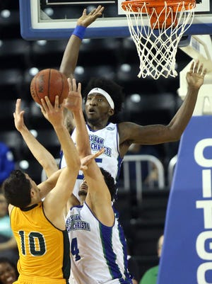 Islanders' Rashawn Thomas reaches for the ball against Southeastern Louisiana on Wednesday, Feb. 8, 2017, at the American Bank Center in Corpus Christi.