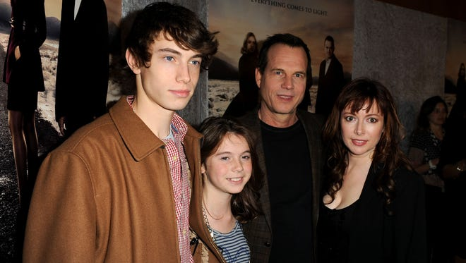 Actor Bill Paxton, who died Feb. 25, (third from left) leaves behind a wife Louise Paxton (right) and children James Paxton and Lydia Paxton.