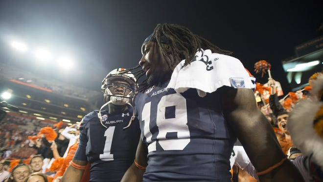 Auburn wide receivers Sammie Coates and D'haquille Williams celebrate with fans. Auburn wide receiver Sammie Coates (18) and Auburn wide receiver D'haquille Williams (1) celebrate with fans after Auburn defeated LSU 41-7 on Saturday, Oct. 4, 2014, at Jordan-Hare Stadium in Auburn, Ala.