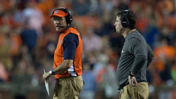 Auburn head coach Gus Malzahn talks to Auburn defensive