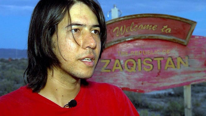 In this video frame grab taken on June 29, 2013,  Zaq Lansberg stands on acres of land in northwestern Box Elder County, Utah.   Lansberg built his own sovereign nation called Zaqistan on a remote piece of land in Utah.  In the decade since he bought the land, Landsberg has also added a supply bunker and a robot sentry to guard the plot in Box Elder County, about 160 miles north of Salt Lake City. (Mike DeBernardo/KSL-TV via Deseret News via AP)