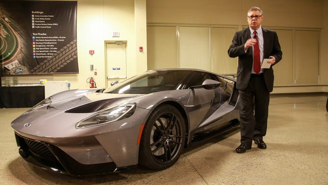 Paul Linden, of Ford Avance Mechanism for Body Exterior stands next to the Ford GT with Gorilla Glass windshields at the Dearborn Development Center in Dearborn.
