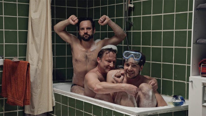 """Stefan Pohl, Simon Jaritz and Rainer Wöss play three brothers trying to re-create a childhood photo in """"The Bathtub."""""""