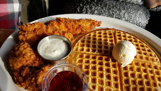 "The ""Tender Love,"" three chicken tenders and a waffle. This is at Kuzzo's Chicken & Waffles on Livernois in Detroit."
