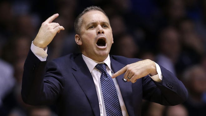 Butler Bulldogs head coach Chris Holtmann calls a play to his players in the second half of their game Wednesday, Mar 2, 2016, evening at Hinkle Fieldhouse in Indianapolis. The Butler Bulldogs defeated the Seton Hall Pirates 85-78.