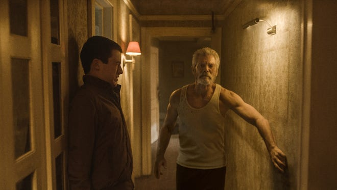"Dylan Minnette, left and Stephen Lang in ""Don't Breathe."""