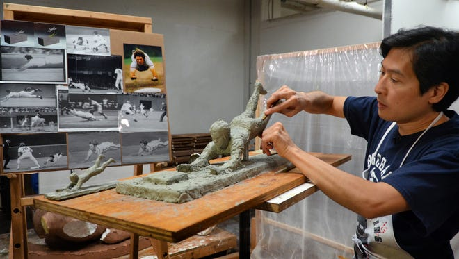 Tom Tsuchiya's works on the clay model of the Pete Rose statue coming to the Great American Ball Park in 2017.