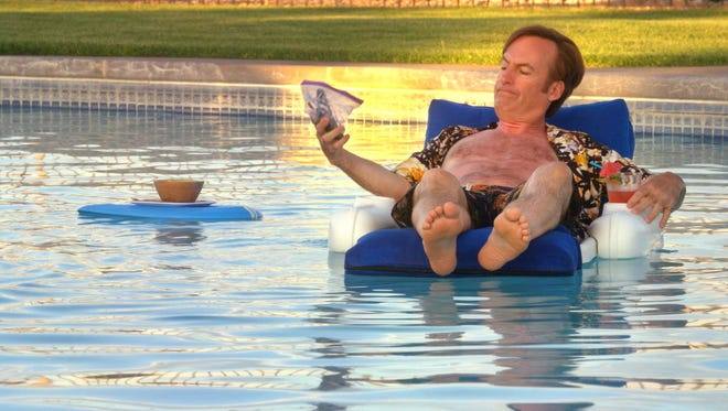 "Jimmy McGill, previously Saul (Bob Odenkirk), lounges in the pool, contemplating giving up law and scowling at his cell phone wheneeer anyone decides they ""Better Call Saul."""
