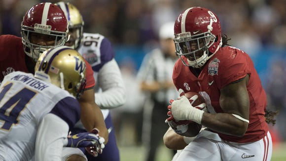 Alabama running back Bo Scarbrough (9) scores a touchdown during the Peach Bowl playoff game between Alabama and Washington on Saturday, Dec. 31, 2016, at the Georgia Dome in Atlanta, Ga.