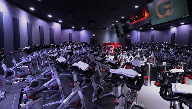 The CycleBar theater features 50 Schwinn bicycles with special bars added for arm exercise. Big screen televisions, music and lighting will be used for various classes at the facility.