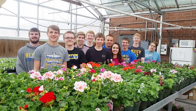 Benton FFA students in their greenhouse Blaine Volesky, Brody Semelroth, Bryce Timmerman, Sam Becker, Parker Nolan, Stuart Tiedemann, Brandon Venneman, Ally Bierschenk, Christian Atkinson,Riley Nolan, and John Crawford. Not pictured are Shelby Karr and Tyler Miller. They plan a flower and vegetable sale in Van Horne.