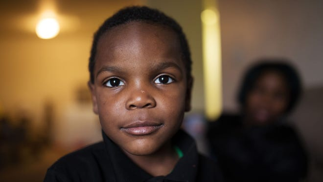 Sincere Smith, 4, in Swartz Creek on Wednesday May 10, 2017. He became one of the most recognized faces of the Flint water crisis when his picture appeared on the cover of Time Magazine last year. After that, Smith's mother moved her family outside the city of Flint. Sincere's skin, once itchy and irritated, has healed.