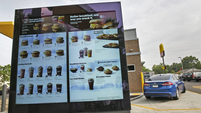 Outdoor digital menu boards at the drive-thru are some of the updates at the newly renovated McDonald's at 3435 W. 16th St., Wednesday, July 12, 2017.