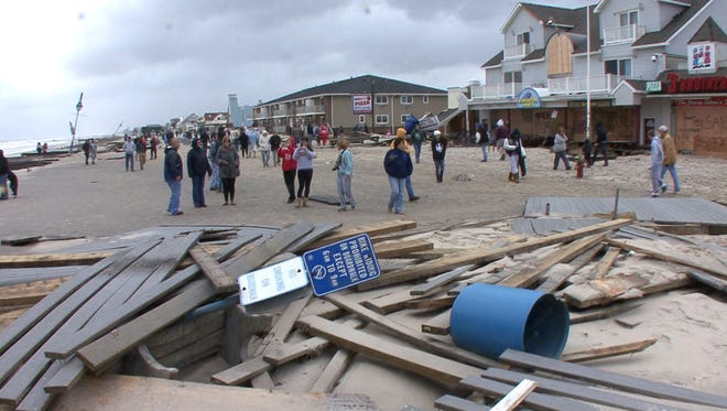 Belmar, NJ-10/30/12- Hurricane Sandy Aftermath-Bob Bielk/ Asbury Park Press Staff Photographer: Aftermath of hurricane Sandy on the Belmar, NJ beachfront. The pilings are all that is left of the boardwalk .