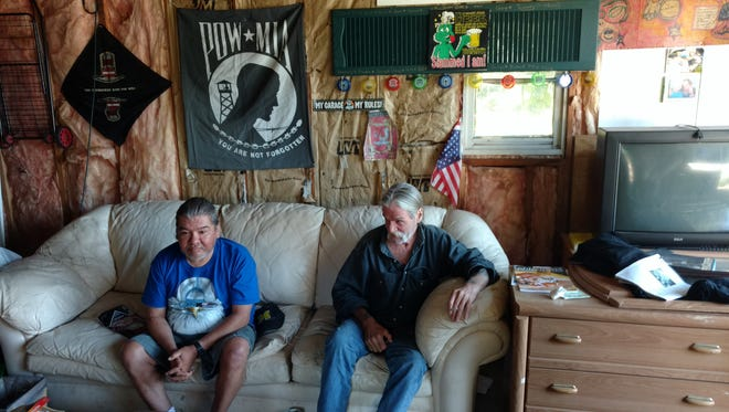 Dann's House residents Doug and David in the garage on May 25, 2018.