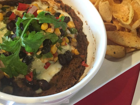 Black bean hummus, guacamole made with Greek yogurt and melted mozzarella go into the Hoss Dip at Big Lug Canteen.