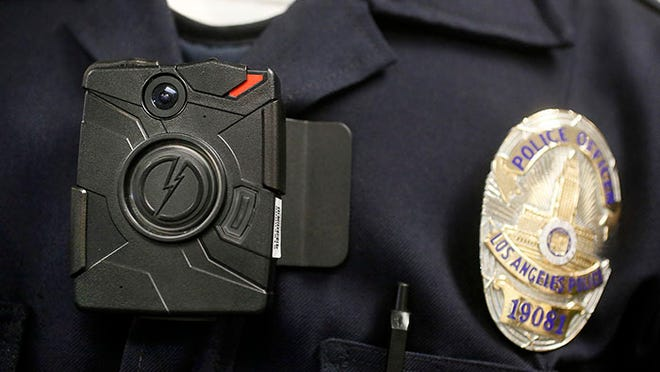 File photo of a Los Angeles Police officer wearing an on-body camera during a demonstration for media in Los Angeles.