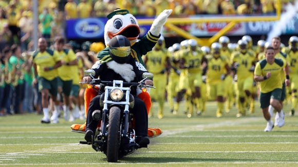 The Oregon Duck mascot rolls in on a motorcycle before Oregon pulls away from Michigan State 46-27 in a matchup of national college football powers at Autzen Stadium in Eugene.