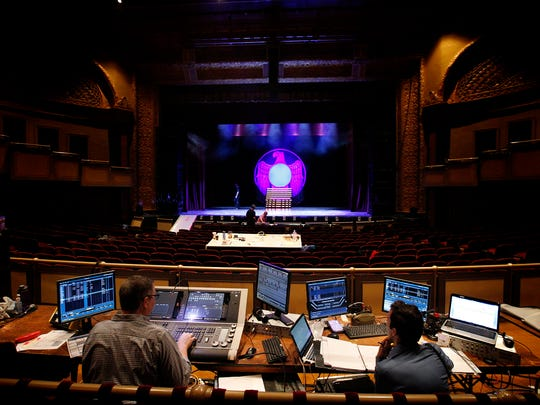 Charlie Morrison, left, and Michael Megliola, both from Big League Productions, survey their stage lighting work at the Clemens Center Friday.