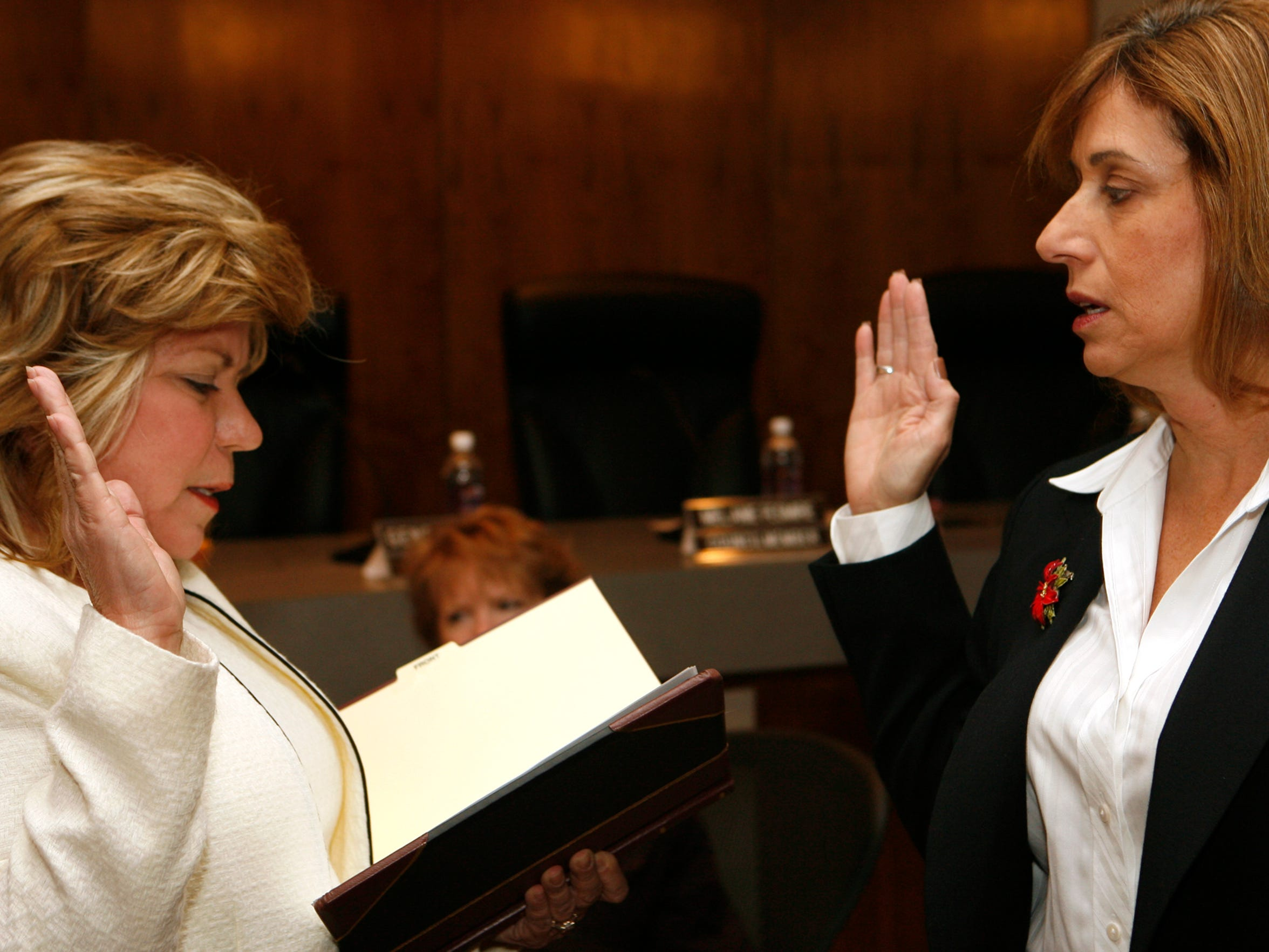 Indio City Clerk Cynthia Hernandez (left) administers the oath of office to newly elected Indio City Council member Elaine Holmes on December 1, 2010 at Indio City Council Chamber.