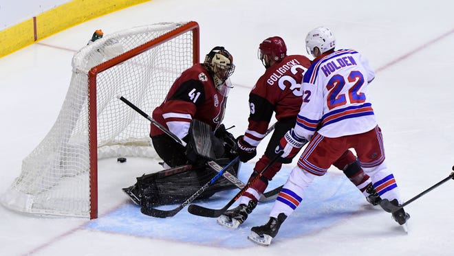 Dec 29, 2016: New York Rangers left wing Matt Puempel (not pictured) scores on Arizona Coyotes goalie Mike Smith (41) as defenseman Alex Goligoski (33) and defenseman Nick Holden (22) look on during the first period at Gila River Arena.