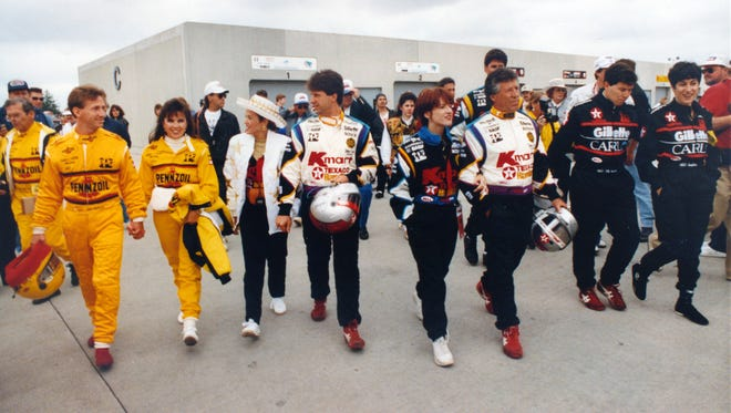It was a family reunion before the 1991 race as (from left) racers John, Michael, Mario and Jeff Andretti, accompanied by family members, walked through Gasoline Alley.