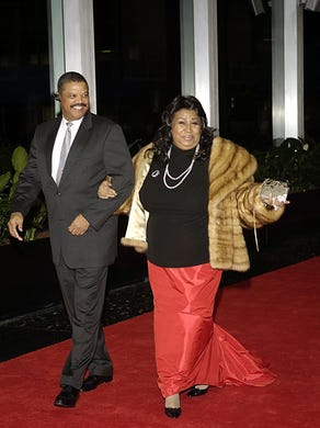Aretha Franklin and her escort William Wilkerson arrive