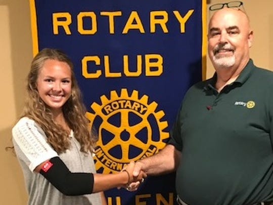 Paul Thomas, president of the Rotary Club of Abilene, congratulates Katlin Callaway for her participation in the Rotary Youth Leadership Awards in Denton.
