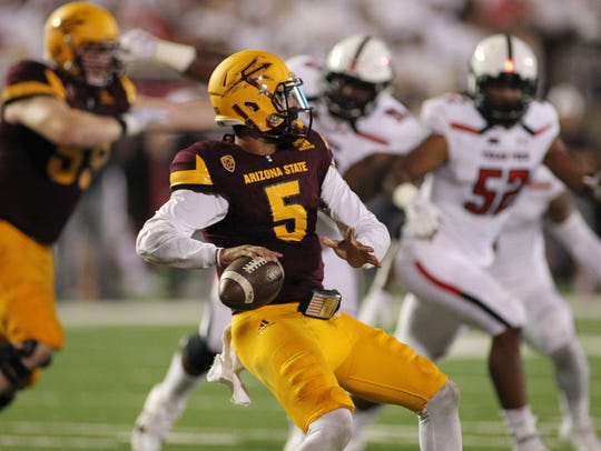 Arizona State quarterback Manny Wilkins drops back