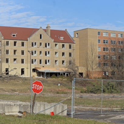 Fencing has gone up around the former Reid Hospital