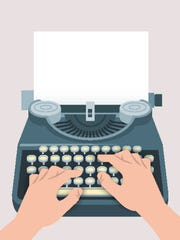 Retro manual typewriter with printing hands and sheet