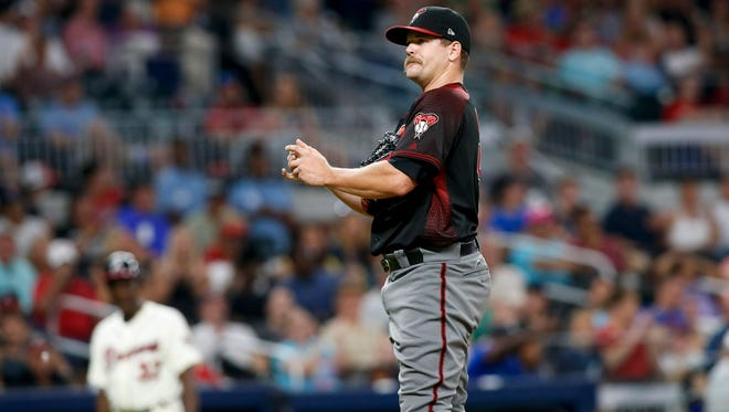 Jul 15, 2017; Atlanta, GA, USA; Arizona Diamondbacks relief pitcher Andrew Chafin (40) shows emotion after being called for a balk against the Atlanta Braves in the sixth inning at SunTrust Park. Mandatory Credit: Brett Davis-USA TODAY Sports