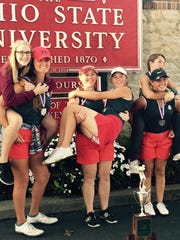 Shelby's girls celebrate their runner-up finish in the state golf tournament.