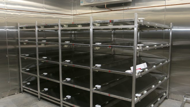 Bodies will be stored on racks in this cooler at about 40 degrees.