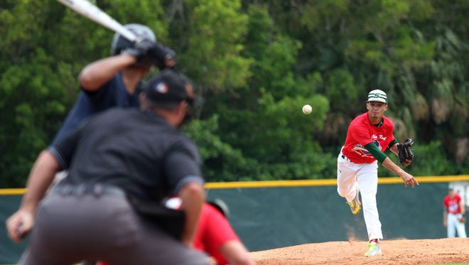 Seacrest's Josue Rivera pitches for the American Team during the inaugural John Kruk Senior All-Star Game at Seacrest Country Day School on June 3, 2017.