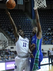 ACU's Drake Green, left, shoots over a Texas A&M-Corpus
