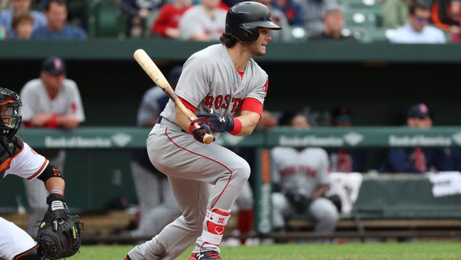 Boston Red Sox outfielder Andrew Benintendi (16) connects on his fifth hit of the game against the Baltimore Orioles at Oriole Park at Camden Yards on April 23.