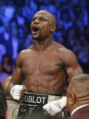 APA history of domestic violence incidents didn't stop Floyd Mayweather from collecting a nine-figure payday Saturday night. Floyd Mayweather Jr., celebrates his unanimous decision victory over Manny Pacquiao, from the Philippines, at the finish of their welterweight title fight on Saturday, May 2, 2015 in Las Vegas. (AP Photo/John Locher)