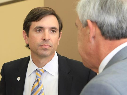 The new Louisiana Association of Business and Industry President Stephen Waguespack, left, visits with University of Louisiana at Monroe President Nick Bruno before speaking at a luncheon Tuesday that was hosted by the Monroe Chamber of Commerce at the Monroe Civic Center.