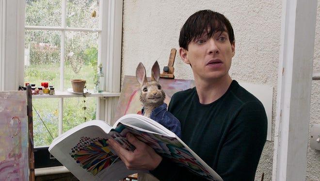 """Peter Rabbit with Mr. McGregor (Domhnall Gleeson) in """"Peter Rabbit."""""""