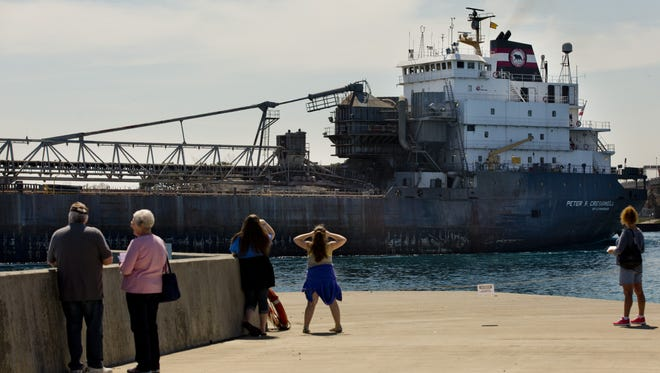 People watch from a pier as the freighter Peter R. Cresswell passes during an open house Saturday at U.S. Coast Guard Station Port Huron. People watch from a pier as the freighter Peter R. Cresswell passes during an open house Saturday, May 2, 2015 at U.S. Coast Guard Station Port Huron.